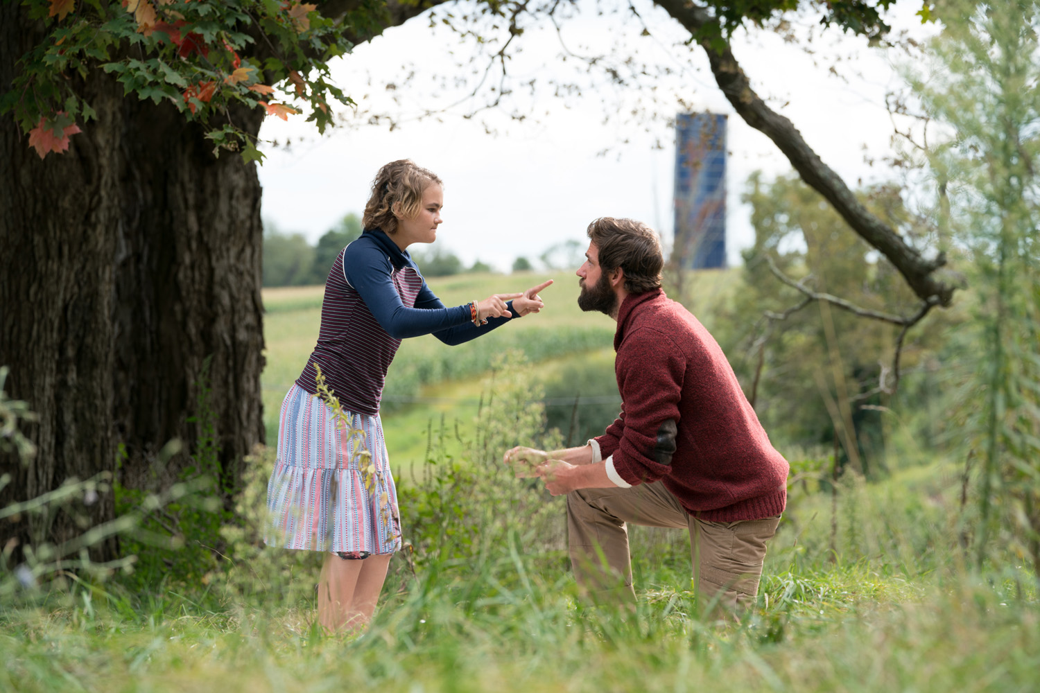 Left to right: Millicent Simmonds plays Regan Abbott and John Krasinski plays Lee Abbott in A QUIET PLACE, from Paramount Pictures.