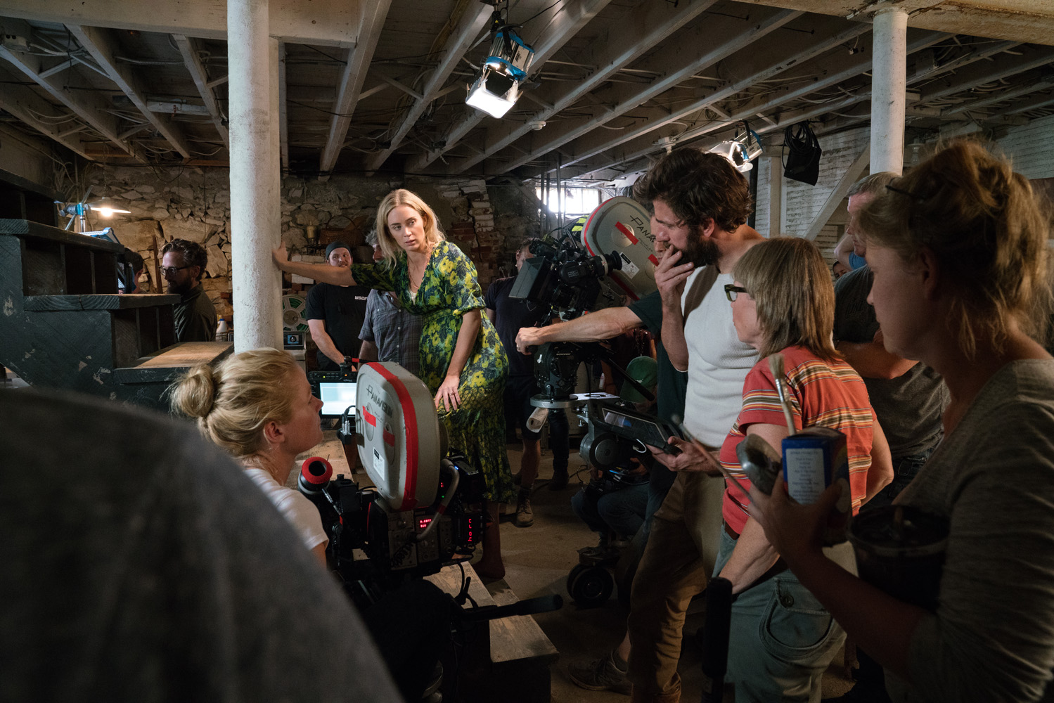 Left to right: Director of Photography Charlotte Bruus Christensen, Emily Blunt and Director/Writer/Executive Producer John Krasinski on the set of A QUIET PLACE, from Paramount Pictures.